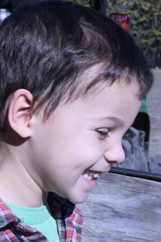 little boy grinning
