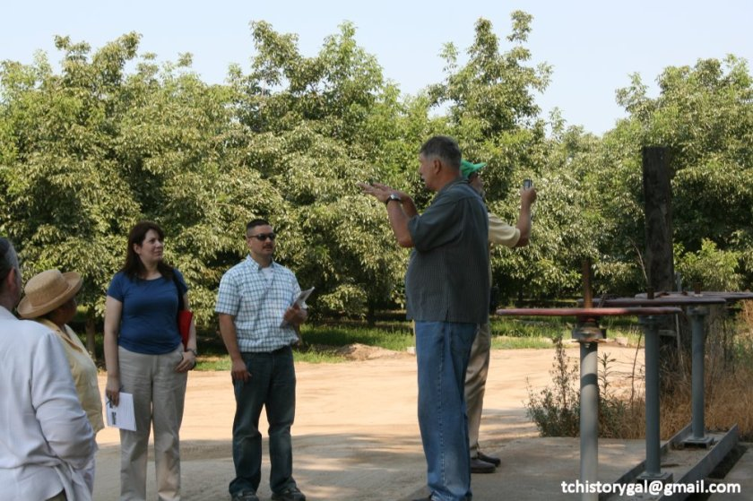 Terry Ommen, Tulare County Historical Society, conducts a tour of Tulare County.  This stop, near the original site of the Election Tree.
