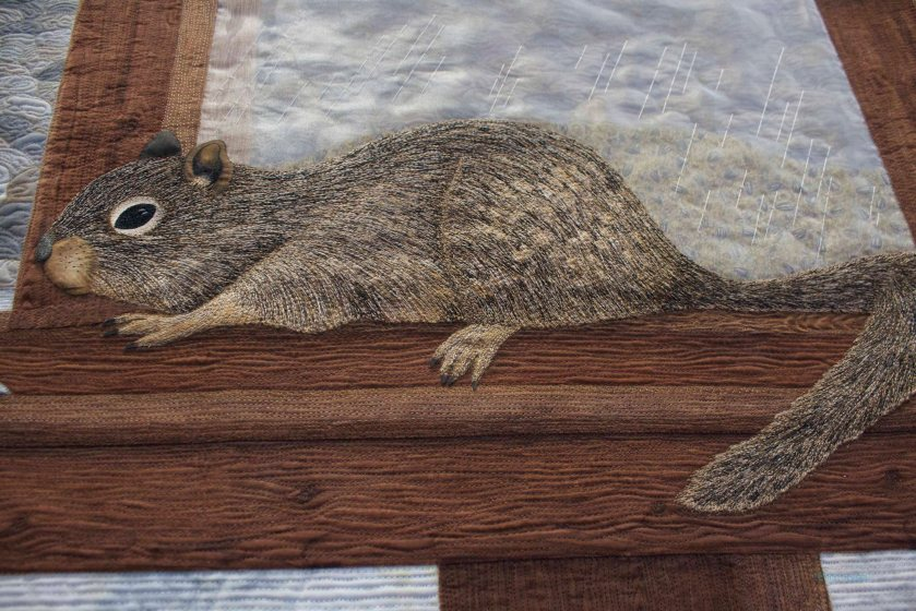 This quilt is up on the wall, but the squirrel is up, too.