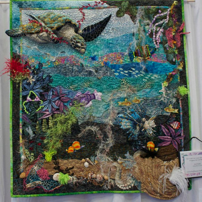 This quilt may have been over blinged.  How many kinds of bling do you see?
