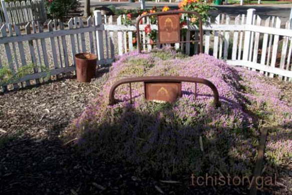 Vince likes to decorate with old furniture in the yard.  He planted this bed in memory of his mom.