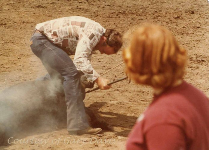 Straddling a calf getting stuck with a hot branding iron is not my idea of a safe job!