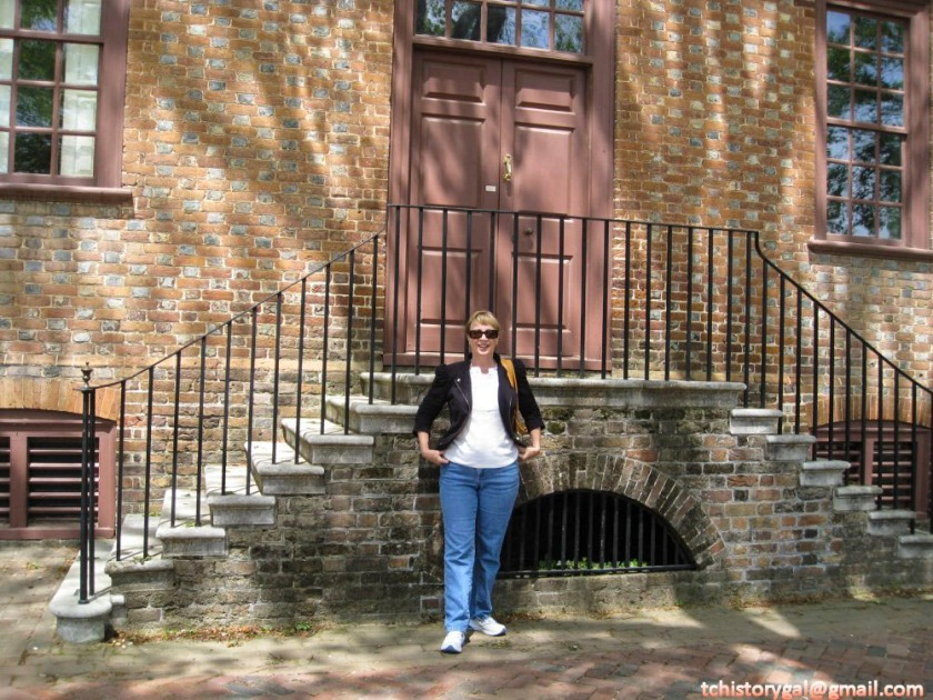 Marsha stands in front of Clementina Rind's house in Colonial Williamsburg.