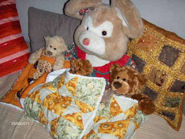 1a Fanny, Manny, Danny and new baby bear with Marsha's quilts