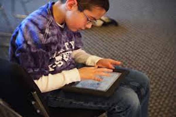 boy using ipad L