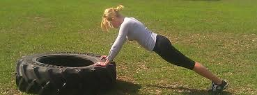 push ups on a big tire.