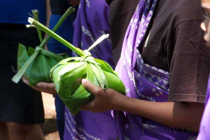 Hawaiian ceremonial dancers keep their cool in purple.