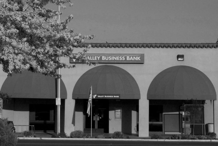 """Bank of America built a new building when the """"brick block"""" on the corner was torn down in 1961. Newer buildings are stucco."""