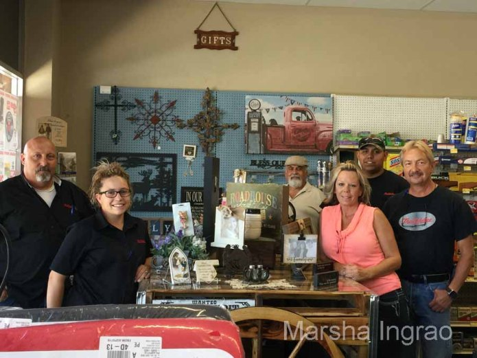 Leeann Jones and Cindy Dorais designed and created the beautiful counter out of found goods at the store: old siding which they painted rusty red, a wagon wheel, and a glass top. They have orders for more.
