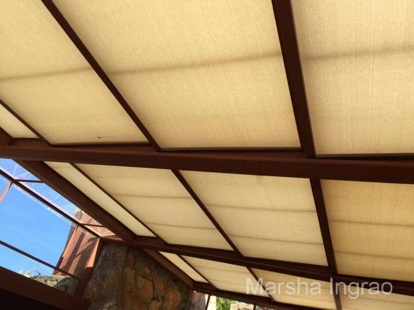 At Taliesin West in Sedona, AZ Frank Lloyd Wright used canvas for the roof. He did not have glass in the windows.