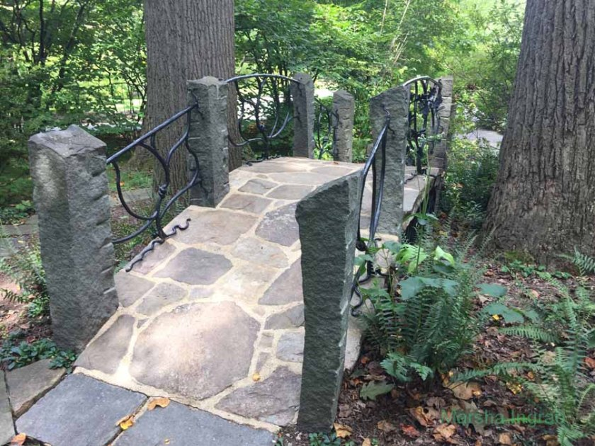 Travel: walking paths Stone troll bridge in Enchanted Forest-Winterthur Gardens