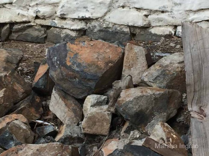 Large stones crashed to the floor of the old barn