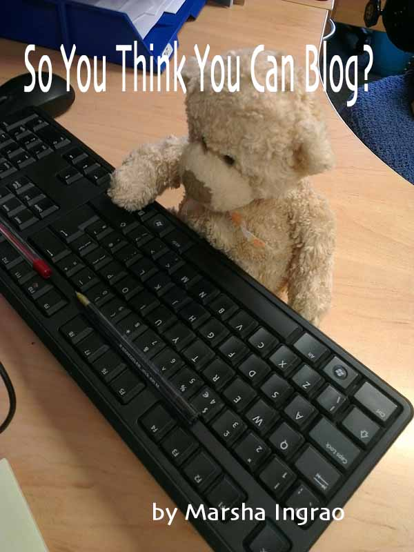 teddy bear typing on a keyboard
