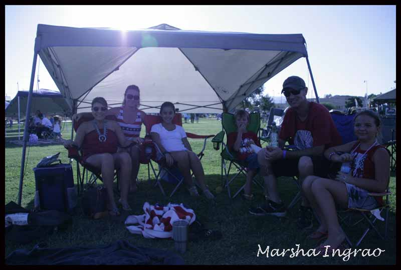 sitting under a shade tent